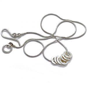 Caroline Jones 7 lucky rings on snake chain 01