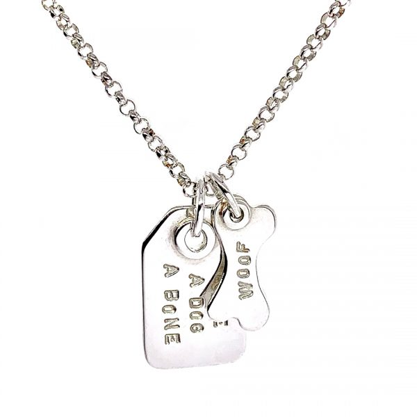 Caroline Jones swing tag necklace with charm 01