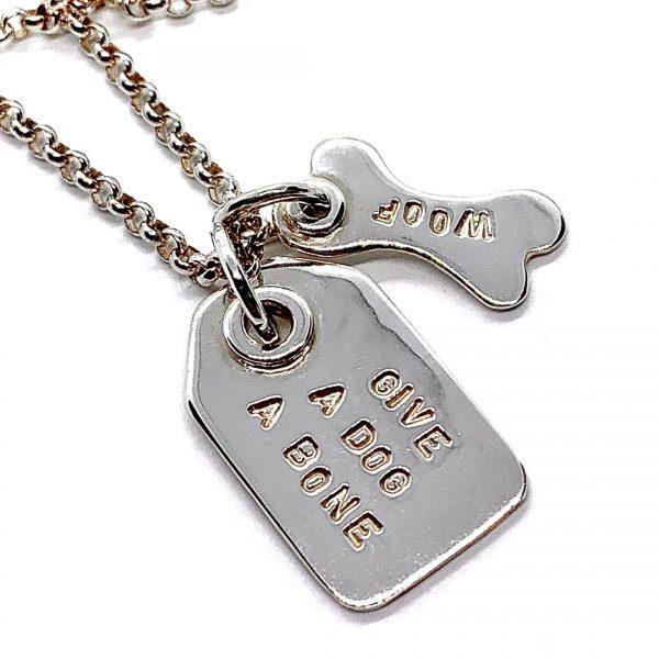 Caroline Jones swing tag necklace with charm 02